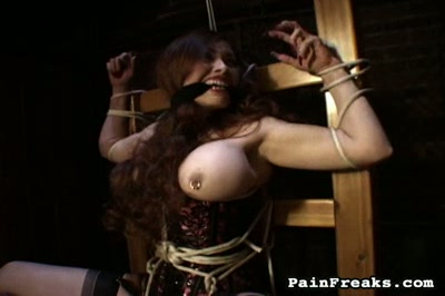 Huge tits  huge fake tit bitch is strapped into an electric chair. Huge fake tit slut is strapped into an electric chair