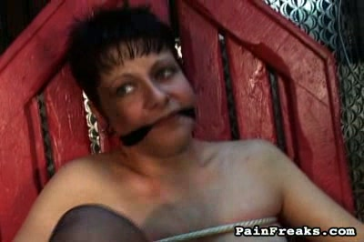 Tit sling. Milf with large butt is being restrained in the basement