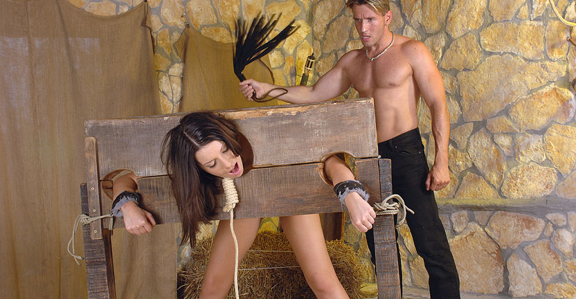 A night in the dungeon. In days of old, a convicted thief was often sentenced to a torturous ordeal.  For her misdeeds, Arianna is given a night in the stocks as punishment. The executioner is delighted to have this divine beauty in his custody.  Unfortunately for Arianna, he has more in mind for her than the judge's sentence He indulges himself in some playful and painful antics with her shapely smooth alabaster body. After being stripped and tied in the stocks the poor girl is made to endure a flogging as the Executioner delights over her full round nether globes.  His next attraction has her pert shapely boobs mauled, pinched and clamped.  The thrill of her squirms and cries induce him to plunge into her helplessly stretched and gaping quim for the second time.  He satisfies his lust for the attractive charge by taking full advantage of her succulent mouth and delectable pussy.  When he is finished, she has been well have sex and abused. Arianna is left tied to a table spread open and tasting his cumshot dabbled across her face, for the rest of the night.