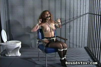 Jailhouse bondage. An auburn beauty, also wearing high heels but in more conventional jail garb, is tied up in the same ways and struggles mightily to get free of her bonds. Then we see the brunette again, still trying to free herself.