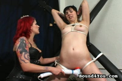 Goddess soma training. The caged woman is required to frig herself while the chained woman is required to submit to vibrator-induced orgasms utilizing a large, electrically powered vibe. We also see lez clit-licking.