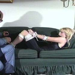 Secret sessions  a bound and gagged blonde struggles to get free after her master ties her up. A bound and gagged blonde struggles to get free after her master ties her up.