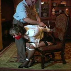House of frazier. Bound and gagged, a young woman is captive to a man and his perverted desires.
