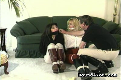 Bondage is my pleasure. A blonde and a brunette are tied up next to each other -- a present for the man in the picture. Then the brunette is freed and licks the blondes boobs while the blonde licks the mans shoe.