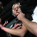 Two harsh captors A blonde victim desperately services the throbbing cocks of her oppressors.