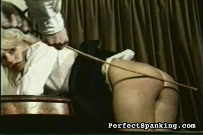 Mutual agreement. A perfect British gentleman canes his young lady friend to show her what discipline should be and how it is effected.