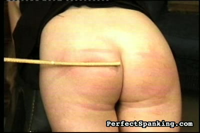 Caning is the name of this game	  we can see the flesh jump and hear the girl moan as the cane leaves stripes across her bare analy   the other two girls have their backs turned not permitted to watch although they do sneak a peek   the dominatrix enjoys . We can see the flesh jump and hear the girl moan as the cane leaves stripes across her bare bottom.  The other two girls have their backs turned, not permitted to watch, although they do sneak a peek.  The dominatrix enjoys playing with her sweet ass, and we imagine that she will use her power to eat some pussy and have hers eaten as well.