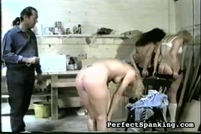Three naughty girls. The brunette is made to touch her toes as the cane rains down blows on her naked ass.