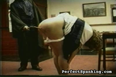 Schoolmasters have all the fun. The third phase of her punishment is the cane.  Down come the panties and smack goes the cane.  She must count and thank her robed master as he causes her big suffering .