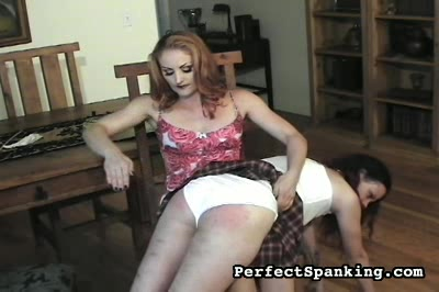 Direct hit to clit. Woman on woman, otk.  But when she stands up and picks up the strap, our unfortunate victim moans.  A second girl stands for her punishment as our mistress brings the strap sharply to bear.
