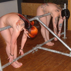 Well tattooed well whipped. We punish two gals here for your pleasure.  Feel free to put yourself in our position.
