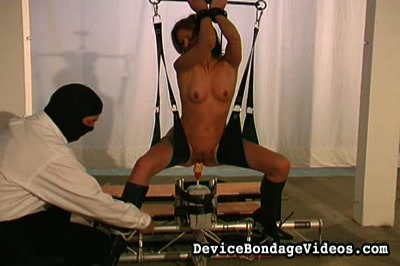 Clamped nipples invade vagina. She is led to the penetration machine and it pumps her full of dildo as she is suspended by arms and thighs.  She moans in ecstasy as the artificial cock bangs her steadily and ever faster.  Her cunt takes a heavy fucking.