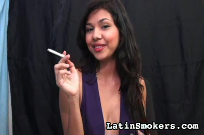 Smoking fetish debut. Marcela lights her cigarette and takes long, effortless drags of smoke into her lungs, exhaling lusty clouds of smoke that veil her face in mystery