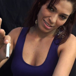 A really exciting latina milf. Paola is a really horny Latina MILF who is not shy about making titillating smoking fetish videos.