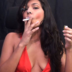Smoking while topless. Marcela is an exceptionally pleasant girl from Colombia who aspires to be a model or actress in America one day.