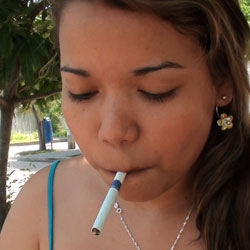 Curvy babe smoking closeup. This is a babe I never get tired of watching smoking.