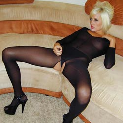 Vision in a catsuit. Jodie Starr strips out her catsuit and encourages you to fuck-off so you can both ejaculate together