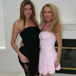 Two babes teasing on video. A big combo as the girls sit on the couch in short dresses, heels and sheer pantyhose as they stroke and caress each other.