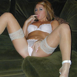 Naughty new bride. Bella just got married but she can`t wait for her wedding night to show off her white lace lingerie.