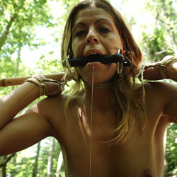 Outdoors bdsm training. Her BDSM master, wearing a gag mask,