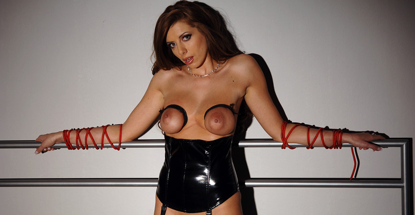 She moans and mumbles. She moans and mumbles through a ball gag fixed in her mouth.