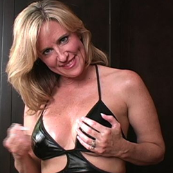 Pleasant milf gives jerk off instruction   she knows just what she wants   none of this young girl teasing   she could be your aunt or your moms friend. She knows just what she wants.  None of this young girl teasing.  She could be your aunt or your moms friend.