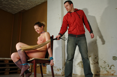 Correcting her poor behavior. Holding her hands out flat, this poor behaving babe gets a kind of spanking she's never experienced before