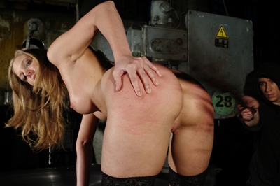 Strike her while she s hot. That hot body is pressed against cool steel while she's made to take a inhuman whipping. Her arse turns bright red as the flogging continues
