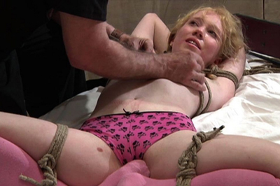 She loves breast bondage. There was no time for her to take off her pink panties and show that pleasant wet slippery beaver but we can see her ass which turned red quite fast after the spanking.