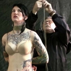 Cool looking slave ava. Ava is a star of many bondage videos and in this one you are going to see her as she is just standing with her hands tied behind her back as her master is putting a red gag ball in her mouth