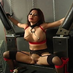 Lusty asian slave. This asian bondage scene features a hot asian sex slave bound up in a machine.