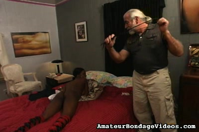 Black babe in bdsm. He started using a long silver dildo on her and shoved it all the way deep inside of her slippery cunt while her nipples were rock violent and ready for twisting and squeezing