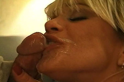 Loving that dick. Exhaling onto his cock, she gobbles up each and every inch.