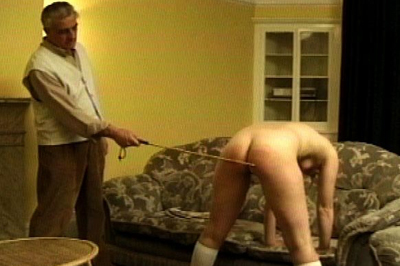 Deserved punishment 1. He can see right through her lie. She definitely deserves to be punished. So he pulls her over his knee and spanks her round jiggly booty with a considerable bare hand.