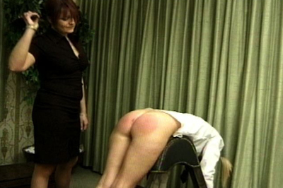 Over the knee spanking 19. She pulls one of the school girls across her knee and gives her a bare handed spanking, as her accomplice watches. dominatrix raises the girls skirt and spanks harder.