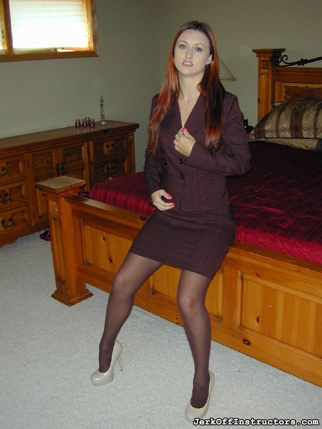 Next applicant karlie montana. Karlie Montana is in her bedroom after a long day of job seeking and she's still in her office attire, ready to interview with you. She's dressed in a libidinous brown skirt suit with matching brown pantyhose and high heels.
