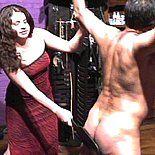 Brunette in evening gown beats man for information